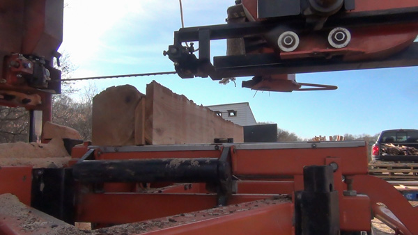 The log is then rotated a final time and we place the live edge boards in with the log.